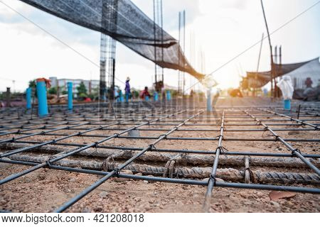 Selected Focus On Reinforced Concrete, Construction Workers Fabricating Steel Reinforcement Bar At T