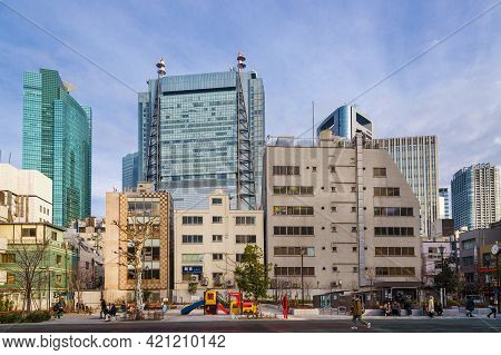 Tokyo, Japan - February 22: Contrasts In Tokyo. Ordinary Life In Shimbashi District Below Modern Sky
