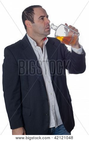 Man Drunk Drinking From A Bottle Of Whisky
