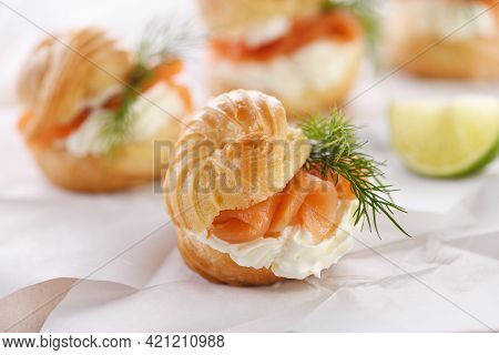 Profiteroles Stuffed With Cream Cheese And Salmon.