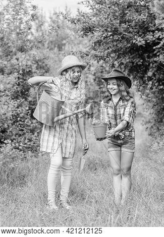 Girls In Hats Planting Plants. Rustic Children Nature Background. Kids Having Fun At Farm. Eco Farmi