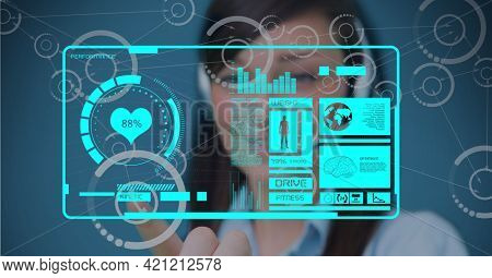Composition of businesswoman touching digital screen with medical data processing. global networks and digital interface concept digitally generated image.