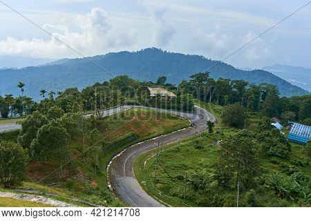 A View From A Height On A Mountain Winding Road In The Tropical Jungle.