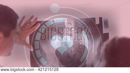 Medical data processing against caucasian male and female doctor examining x-ray report. medical research and technology concept