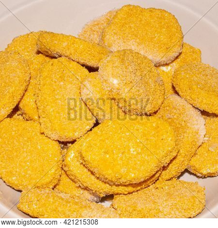 Raw Chicken Nuggets In Breadcrumbs Background.frozen Chicken Nuggets Top View.