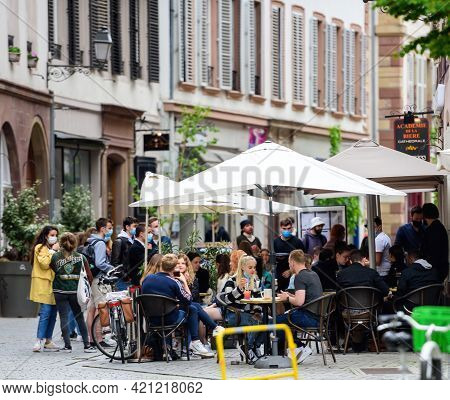 Strasbourg, France - May 19, 2021: People Eating Drinking At The Terrace Of Academie De La Biere On