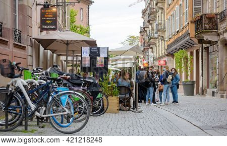 Strasbourg, France - May 19, 2021: Group Of Girls Waiting To Be Seated At Terrace Of Academie De La