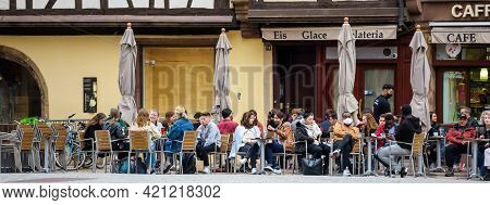 Strasbourg, France - May 19, 2021: People Eating Drinking At The Terrace Of Ice-cream Cafe On Pedest