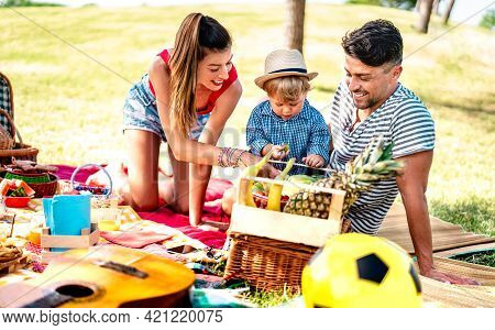 Happy Family Having Fun Together At Picnic Party - Joy And Love Life Style Concept With Mother And F