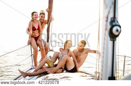 Young Couple Friends Chilling On Sailboat At Sea Ocean Trip - Guys And Girls Having Summer Fun Toget