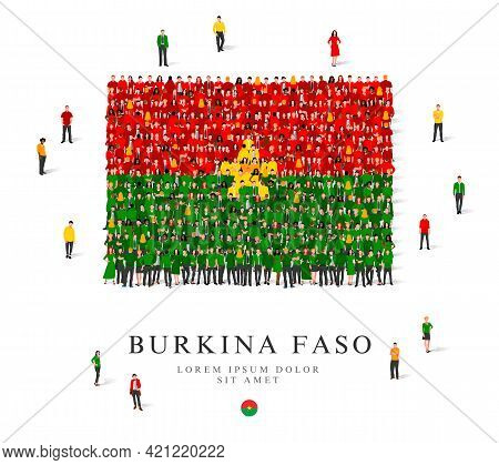 A Large Group Of People Are Standing In Green, Yellow And Red Robes, Symbolizing The Flag Of Burkina