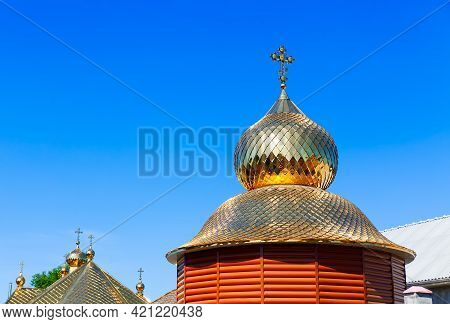 Wooden Church With Golden Cupola . Cross On The Dome Top