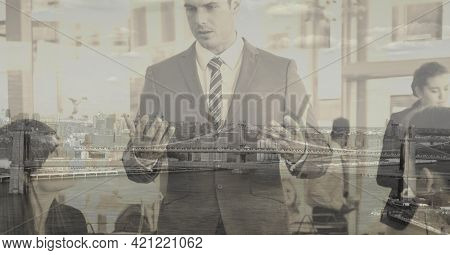 Composition of caucasian businessman talking in office over cityscape. global business and finance concept digitally generated image.