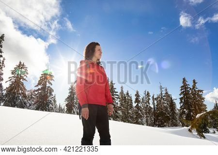 Adventurous White Caucasian Woman Hiking Outdoors In Snow On Top Of Mountain. Sunny Spring Evening S