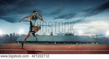 Professional Male Runner, Jogger On Stadium Background. Caucasian Fit Athlete Practicing, Training E
