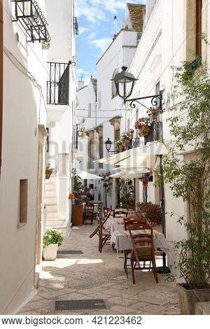 Glimpse Of An Italian Town With Restaurants Outside In Apulia Region, Southern Europe