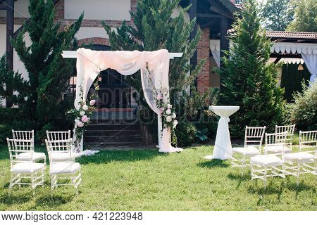 Wedding Decor, Wedding Ceremony Area In Nature, In Garden. Details Of Wedding Arch, Floristry And Tr