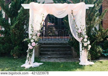 Wedding Decor, Wedding Ceremony Area In Nature, In Garden. Details Of Wedding Arch, Floristry.