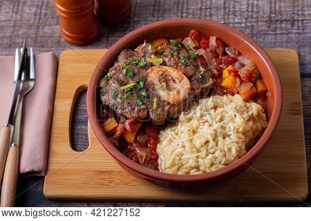 Ossobuco. Veal (beef) Shanks With Saffron Risotto In Milanese, Gremolata And Sauce. Traditional Ital