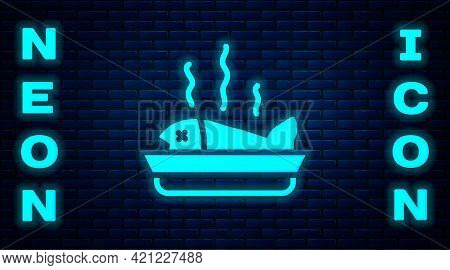 Glowing Neon Served Fish On A Plate Icon Isolated On Brick Wall Background. Vector