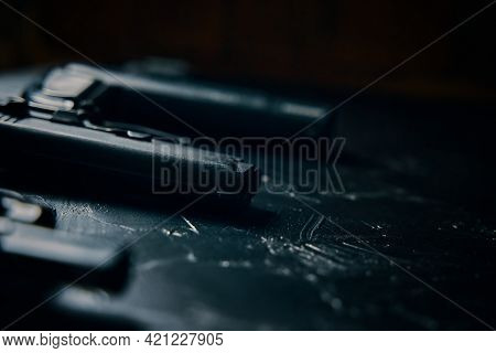 Close-up Of Handguns On Black Table. Criminal Or Police Arsenal. Dangerous Firearms. Black Barrels O
