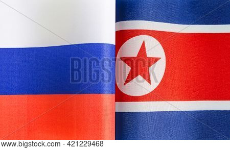 Fragments Of The National Flags Of Russia And The Democratic People's Republic Of Korea Close-up