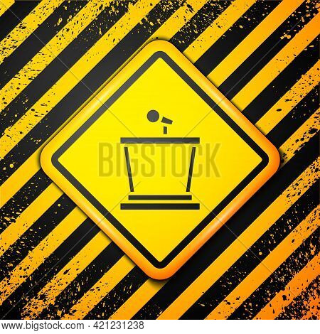 Black Stage Stand Or Debate Podium Rostrum Icon Isolated On Yellow Background. Conference Speech Tri