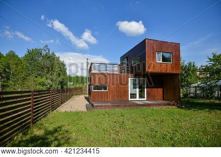 Minsk. Belarus - May 2016: View Of The Brown Modular House Against The Backdrop Of Greenery And Blue