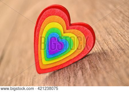 Icon In The Form Of A Rainbow Lgbt Heart On A Wooden Background.the Concept Of Equality Of Sexual Mi