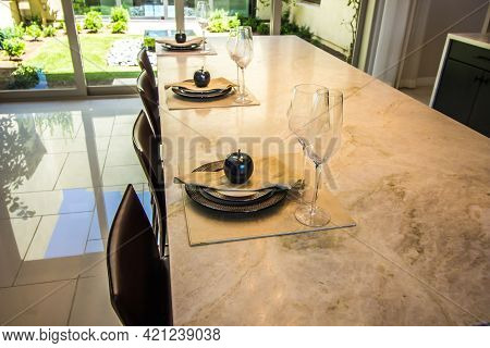 Granite Kitchen Counter With Three Place Settings