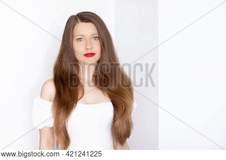 Beautiful Woman With Healthy Gorgeous Long Hair, Natural Brunette Hairstyle And Red Lipstick Makeup,