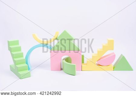 Colorful Set Of Wooden Figures. Children's Construction Kit Made Of Natural Wood. Eco-friendly Toys