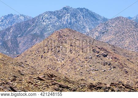 Arid Hills Covered With Eroded Rocks Including Mt San Jacinto Beyond Taken At The Rural Colorado Des