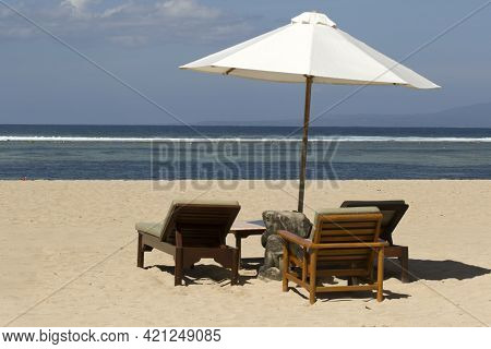 Parasol With Chairs On The Tropical Beach Of Sanur On Bali