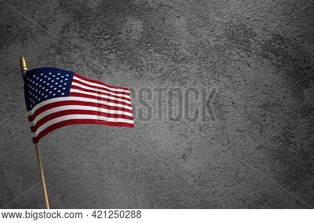 American Flag For Memorial Day, 4th Of July Or Labour Day On Dark Concrete Background