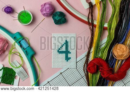 Green Number 4 Cross-stitch Embroidered Surrounded By Accessories For Embroidery: Threads Of Moulin