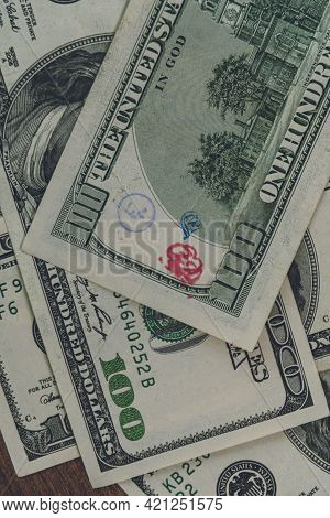 Flat Lay American Cash Banknote 100 Dollars Bill Marked By Inked Symbols. Red And Blue Ink Strange S