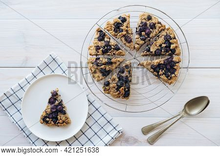 Freshly Baked Oat Blueberry Scones On Cooling Rack On White Wooden Background. Top View, Flat Lay. S