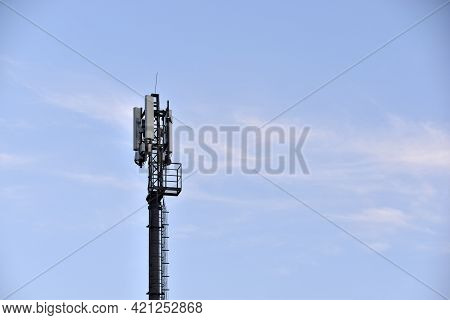 Antenna Transmitter On An Iron Mast In The City