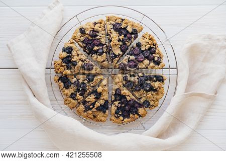 Freshly Baked Oat Blueberry Scones On Cooling Rack On White Wooden Background. Sweet Food With Natur
