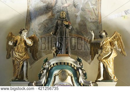 SLAVETIC, CROATIA - JULY 22, 2013: St. Anthony, statue on the high altar in the parish church of St. Anthony the Hermit in Slavetic, Croatia