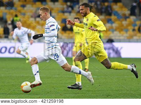 Kyiv, Ukraine - March 11, 2021: Vitaliy Buyalskiy Of Dynamo Kyiv (l) Controls A Ball During The Uefa