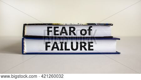 Fear Of Failure Symbol. Books With Words 'fear Of Failure'. Beautiful White Background, Copy Space.