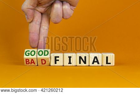 Good Or Bad Final Symbol. Businessman Turns Wooden Cubes And Changes Words 'bad Final' To 'good Fina