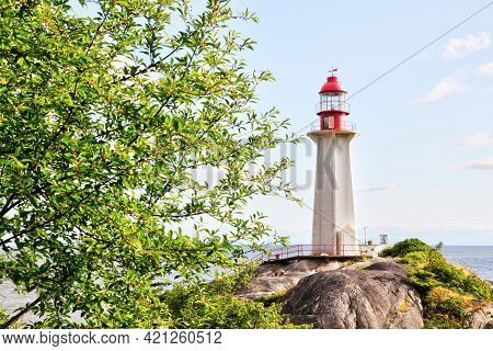 Lighthouse On A Rocky Shore At Lighthouse Park In Horseshoe Bay, West Vancouver, British Columbia, C