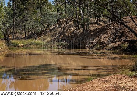 A Country Creek With Dirty Water In A Bushland Environment