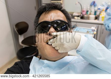 Dentist Taking Teeth Imprint Or Impression Of Patient In Dental Clinic