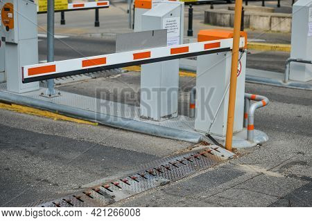 Warsaw. Poland - August 2015: White Red Entrance And Exit Barrier, Spikes Under The Barrier. High Qu