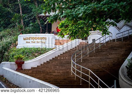Gold Text Banner In Front Of Stair, Thai Language Mean Phra That Doi Tung, It's The Name Of The Famo