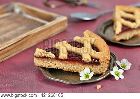 Single Slice Of Pie Called 'linzer Torte', A Traditional Austrian Shortcake Pastry Topped With Fruit
